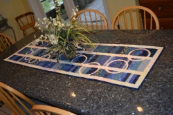 Artistic Blues Tablerunner with a Cascade of Circles