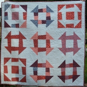 Modern Quilt/Throw with bold Orange and Blue Patches on a White Background