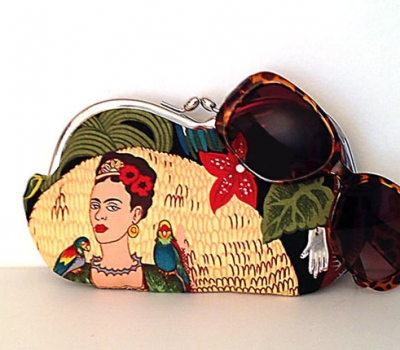 Frida Kahlo with parrots, a large sunglass case, or small clutch
