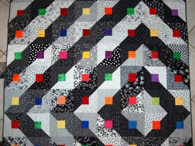 Modern Quilt/Throw, Black and White with bright squares, off-center design layout